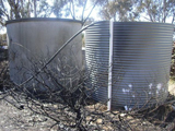 Rainwater tanks in a bush fire